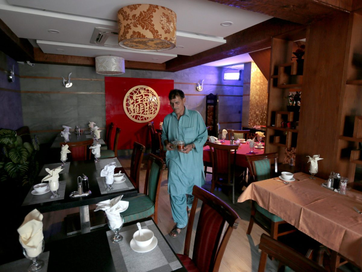 A waiter prepares tables at a Chinese restaurant catering to the growing Chinese population in Islamabad, Pakistan, on June 10, 2017. Photo: Reuters / Caren Firouz