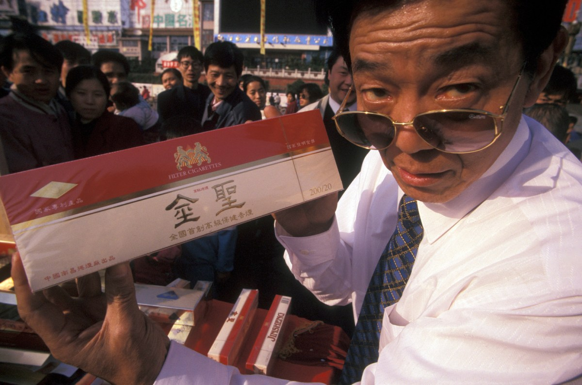 An unidentified cigarette vendor at China's Alcohol and Tobacco Fair held in Jiangxi province's city of Nanchang in March 2017. Photo: iStock/Getty Images