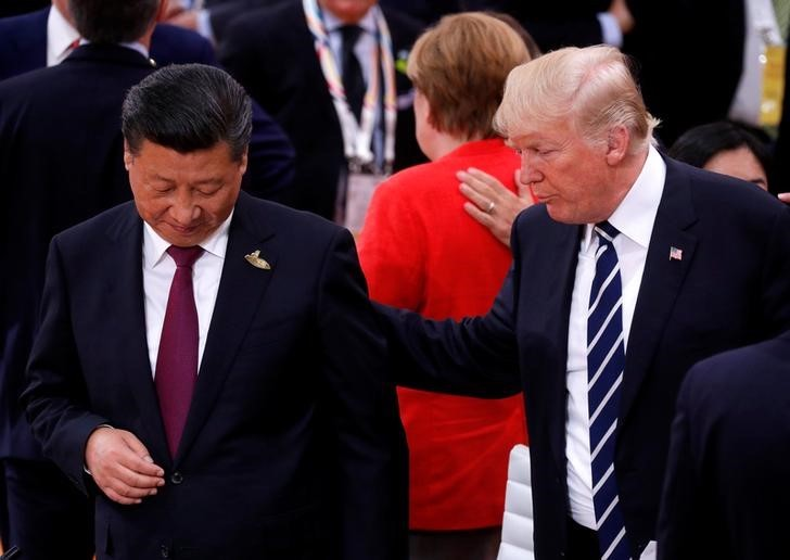 US President Donald Trump talks to China's President Xi Jinping during the G20 leaders summit in Hamburg, Germany July 7, 2017. Photo: Reuters / Philippe Wojazer