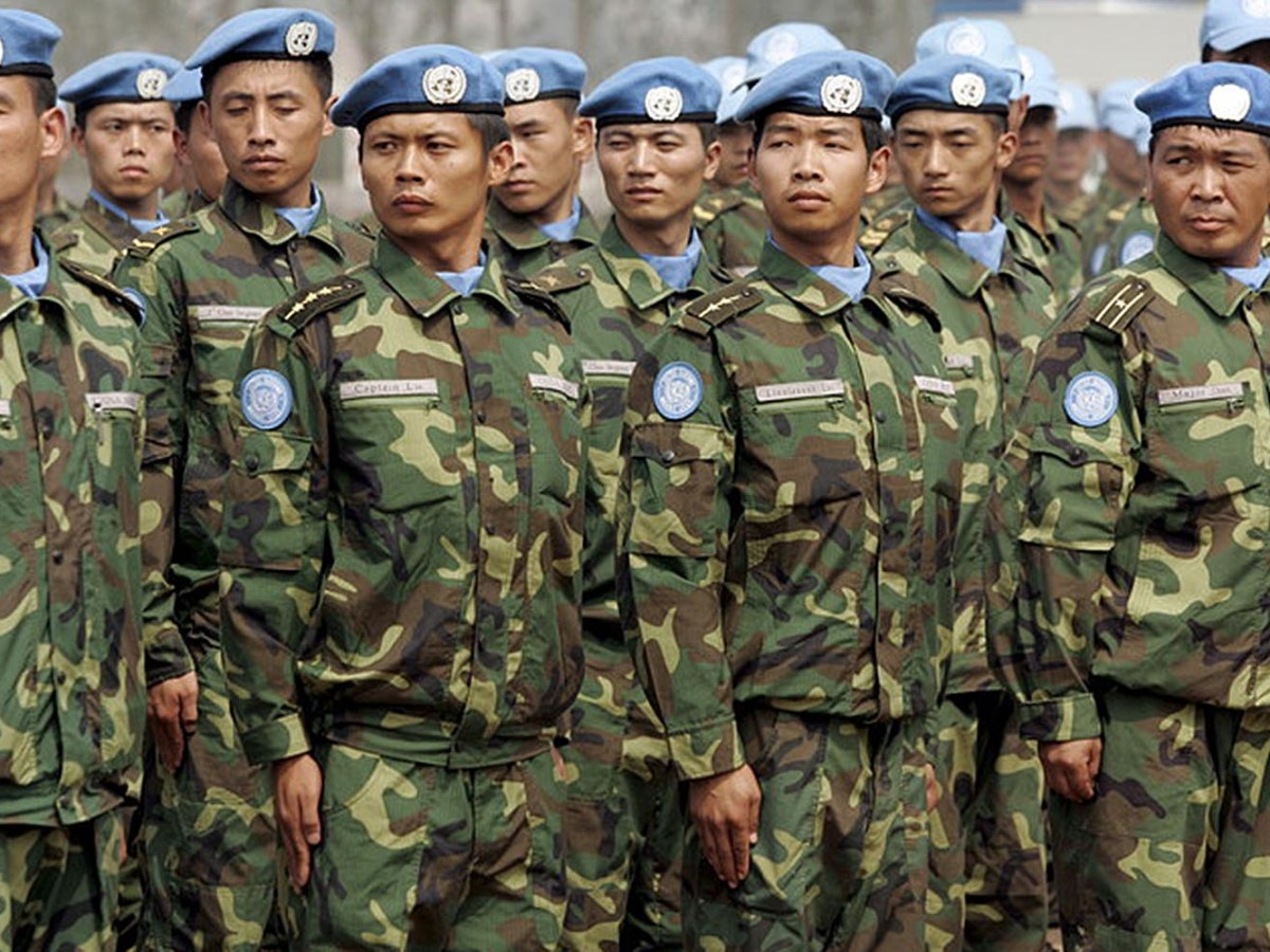 PLA soldiers prepare for a UN peacekeeping mission in Africa. Photo: EPA/Michael Reynolds