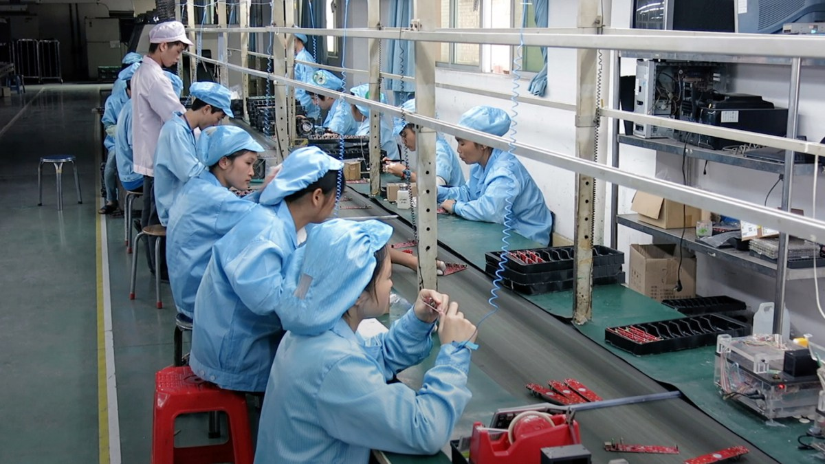 Undercover footage of factory workers in China from the film Death by Design. Photo: Ambrica Productions