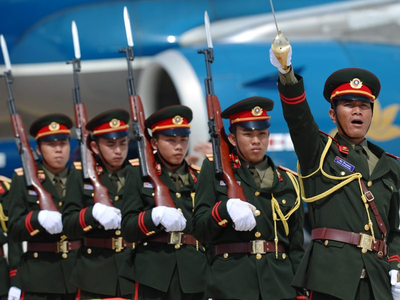A Lao military officer commands an honor guard in a 2012 file photo. Photo: AFP/Hoang Dinh Nam