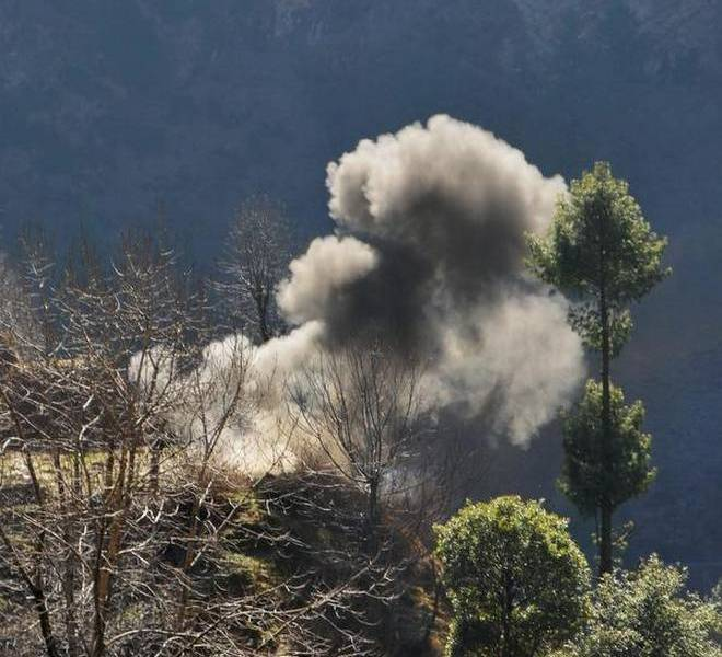 Smoke billows out after a mortar shell was allegedly fired by Pakistani forces near the Line of Control in Jammu and Kashmir's Rajouri district. File photo: The Hindu
