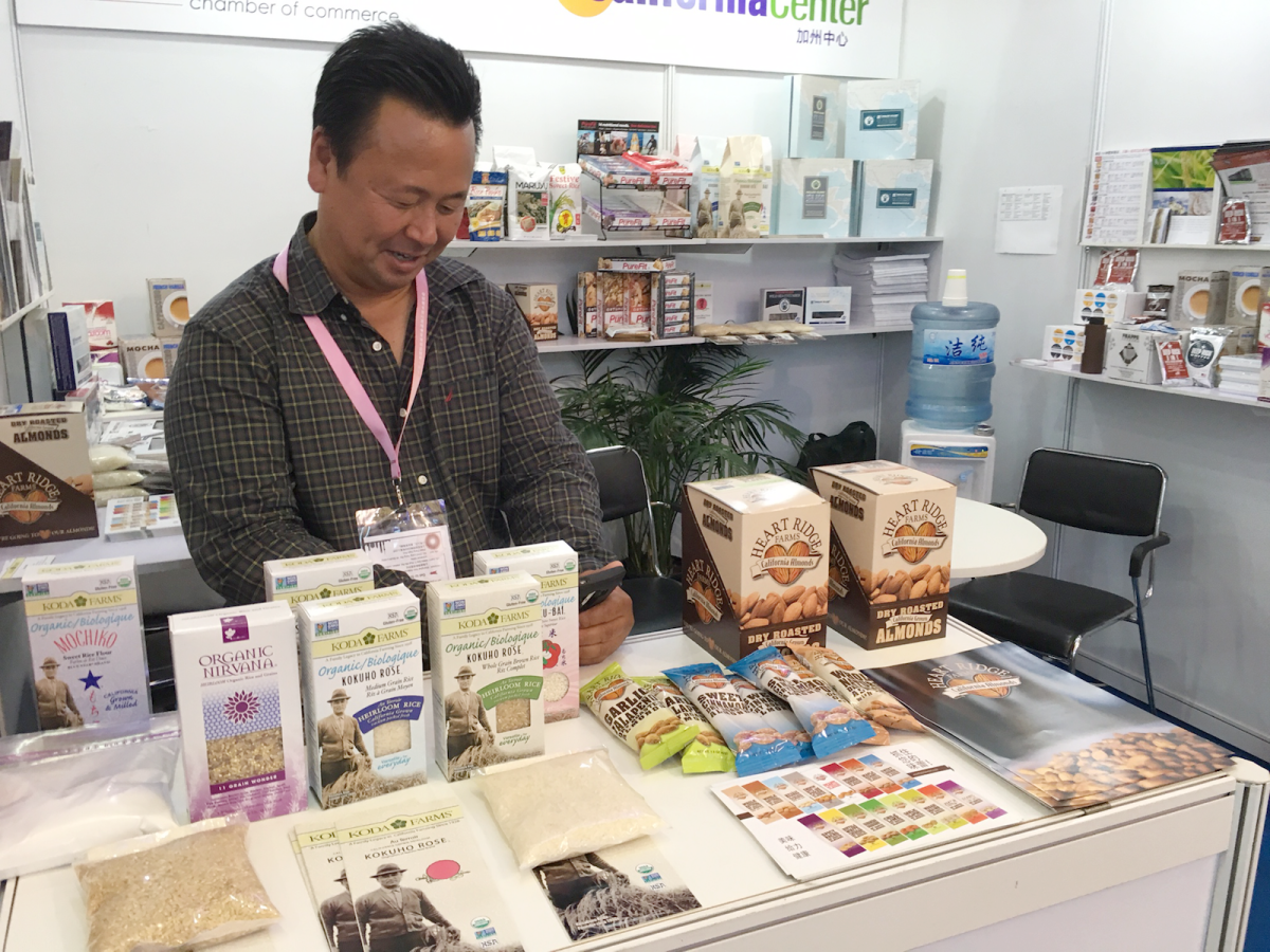 Ross Koda, president of Koda Farms, operates the California products booth at the 2016 SIAL Shanghai food expo. Koda, who began exporting rice to China this year, runs the oldest family-owned rice farm in California, producing a medium-grain Japanese-style heirloom rice, a whole grain brown rice and a Sho-Chiku_Bai sweet sticky rice. Photo:  Courtesy of California Center
