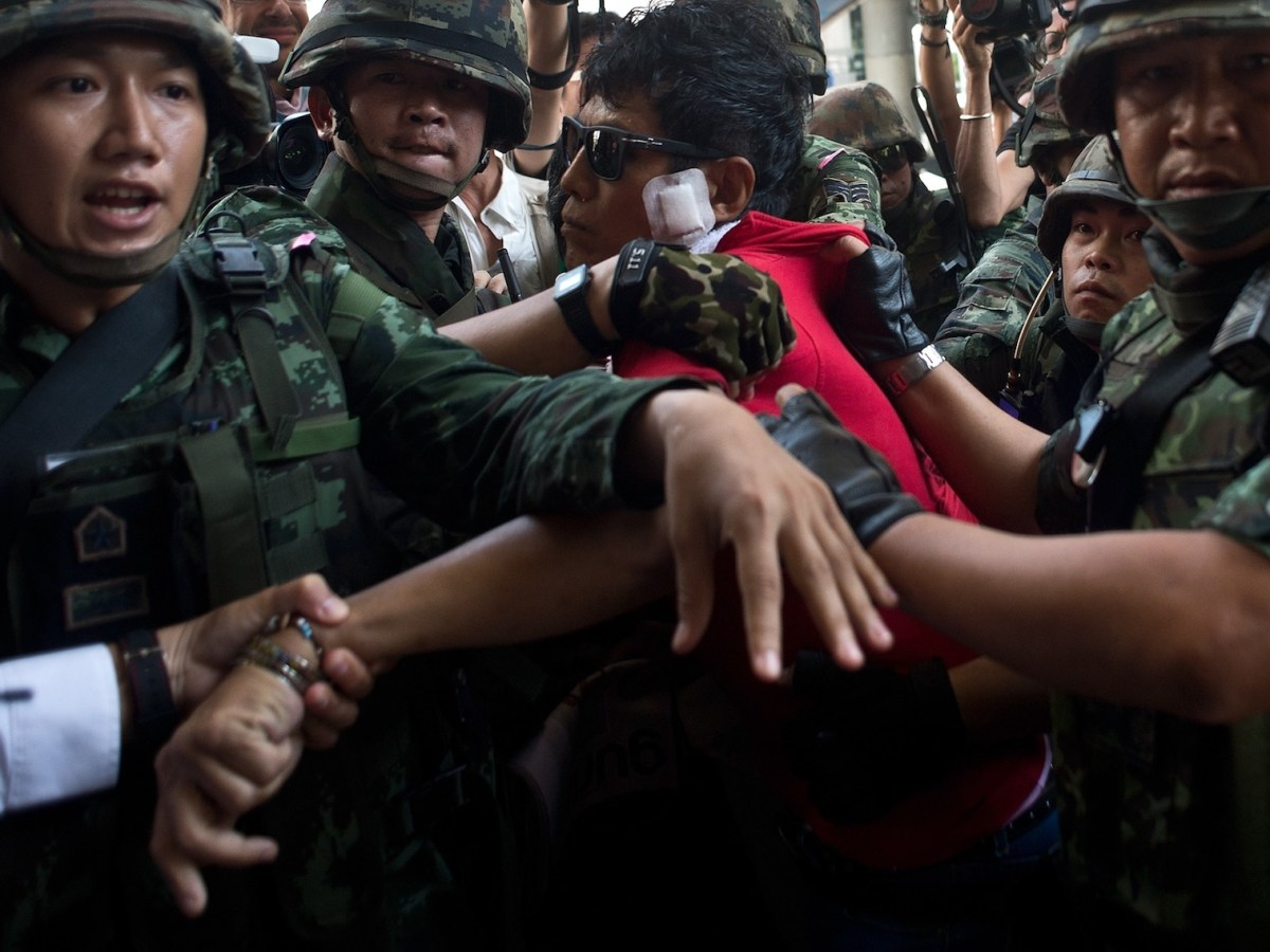 Thai soldiers take away an alleged Red-Shirt protester ahead of a planned gathering in Bangkok in a May 2014 file photo. Photo: AFP/ Manan Vatsyayana