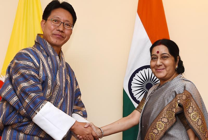 Indian External Affairs Minister Sushma Swaraj, right, shakes hands with Damcho Dorji, her Bhutanese counterpart, in Kathmandu on August 11. Photo: Hindustan Times