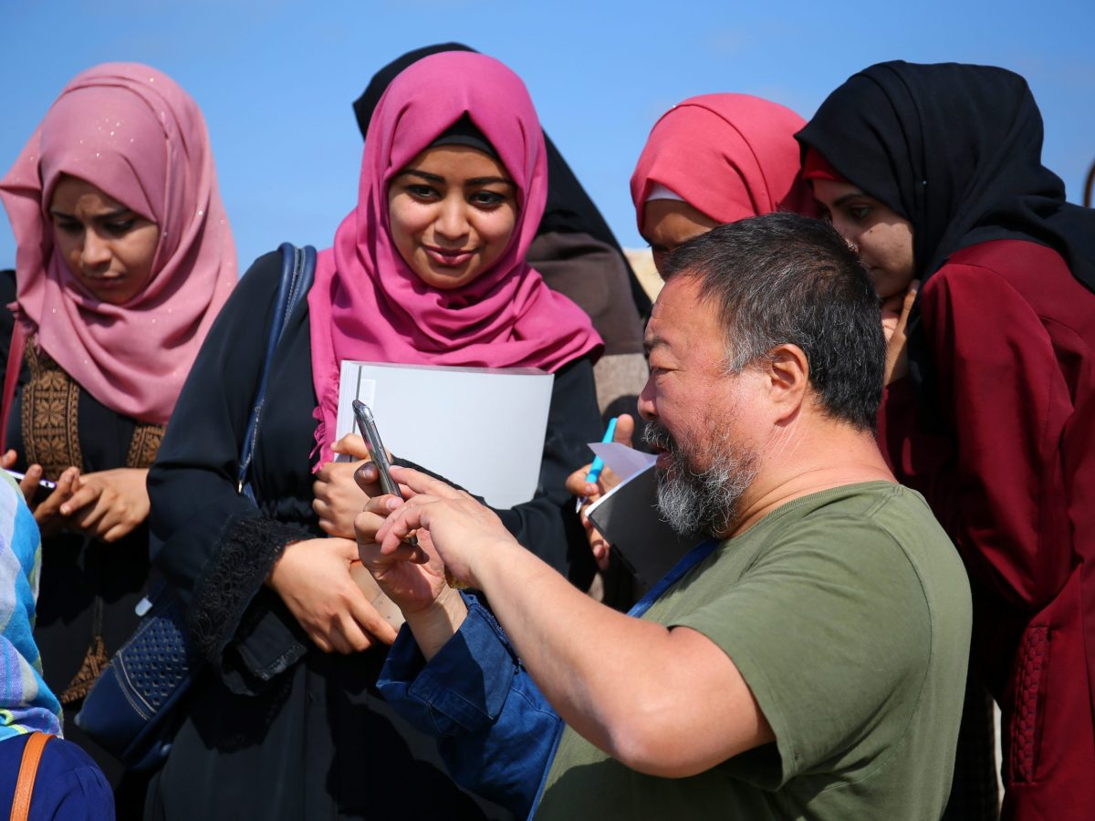 Ai Weiwei takes pictures as he meets with Palestinian university students in Gaza City on May 12, 2016. Photo: AFP / Mohammed Abed
