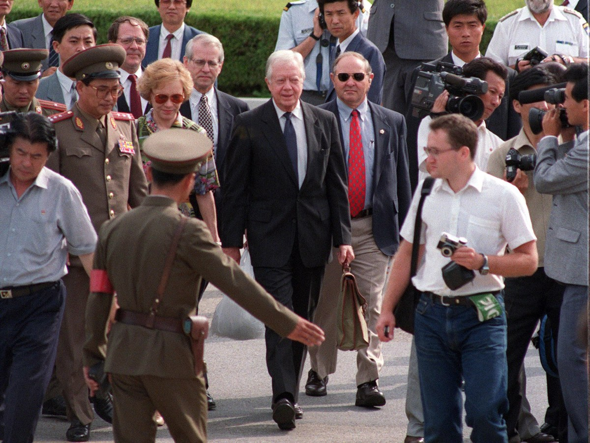North Korean border guards show former US president Jimmy Carter to the South Korea side of the DMZ as they leave North Korea after Carter's controversial meeting with North Korean President Kim Il-sung in 1994. Photo: AFP/Choo Youn-kong