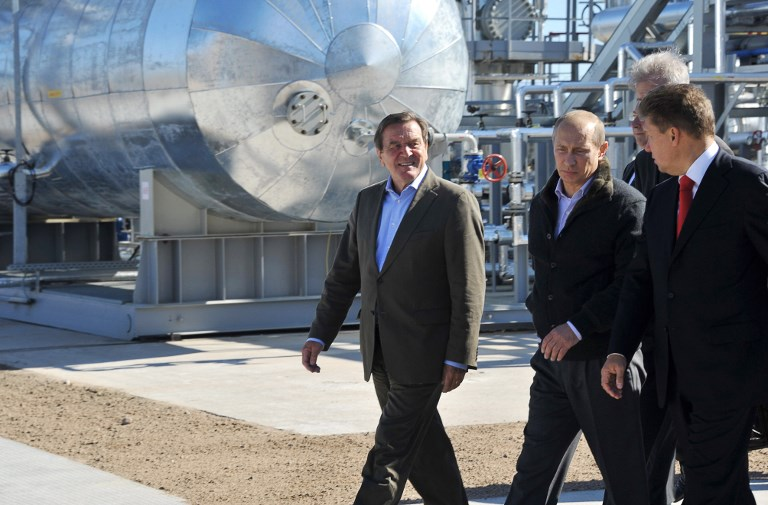Russian Prime Minister Vladimir Putin (C), Gazprom Chief Executive Officer Alexei Miller (R) and former German chancellor Gerhard Schroeder (L) arrive for the inauguration of the Nord Stream Project in 2011. Photo: AFP/Alexey Nikolsky
