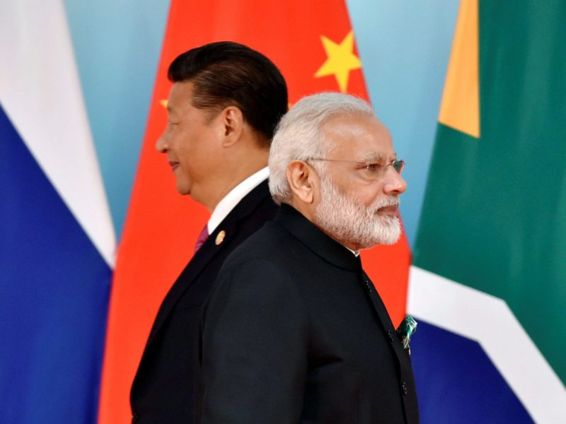 Chinese President Xi Jinping (left) and Indian Prime Minister Narendra Modi attend the group photo session during the BRICS Summit at the Xiamen International Conference and Exhibition Center in Xiamen, southeastern China's Fujian province on September 4, 2017. File Photo: Reuters / Kenzaburo Fukuhara / Pool