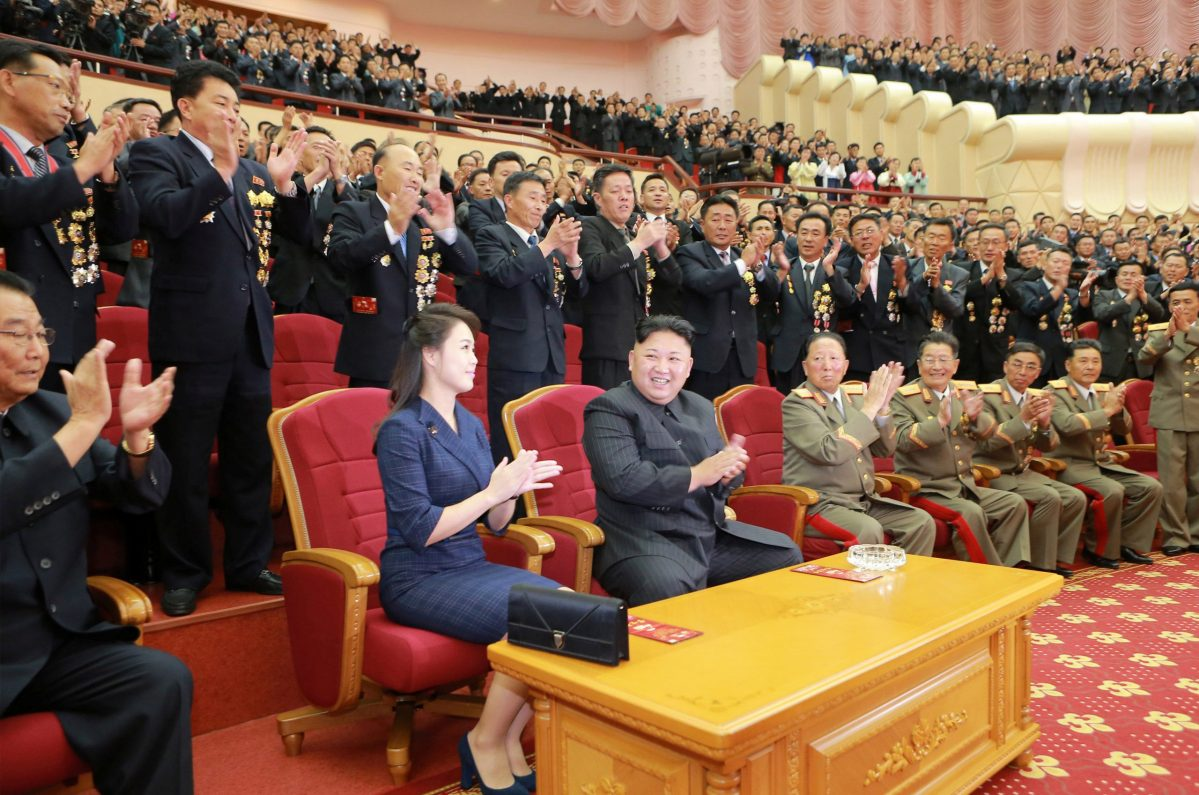 North Korean leader Kim Jong Un claps during a celebration for nuclear scientists and engineers who contributed to a hydrogen bomb test. Photo: KCNA via Reuters