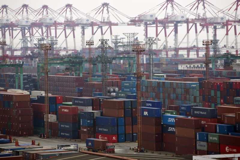 Containers are seen at a port of Shanghai Free Trade Zone, February 11, 2014. Photo: Reuters/Aly Song