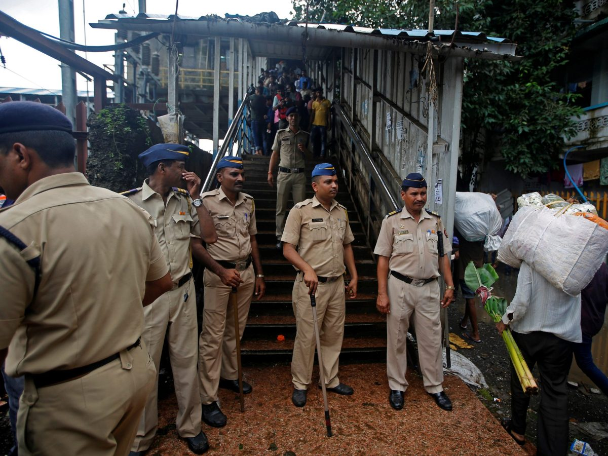 Policemen inspect the site of a deadly stampede at Parel and Elphinstone Road stations in Mumbai on Friday. Photo: Reuters