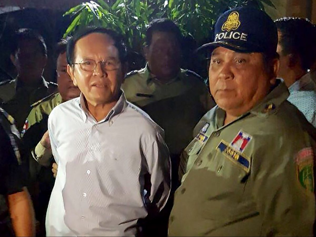 Cambodian opposition leader Kem Sokha (L) is arrested and escorted by police at his home in Phnom Penh on September 3, 2017. Photo: AFP/Stringer