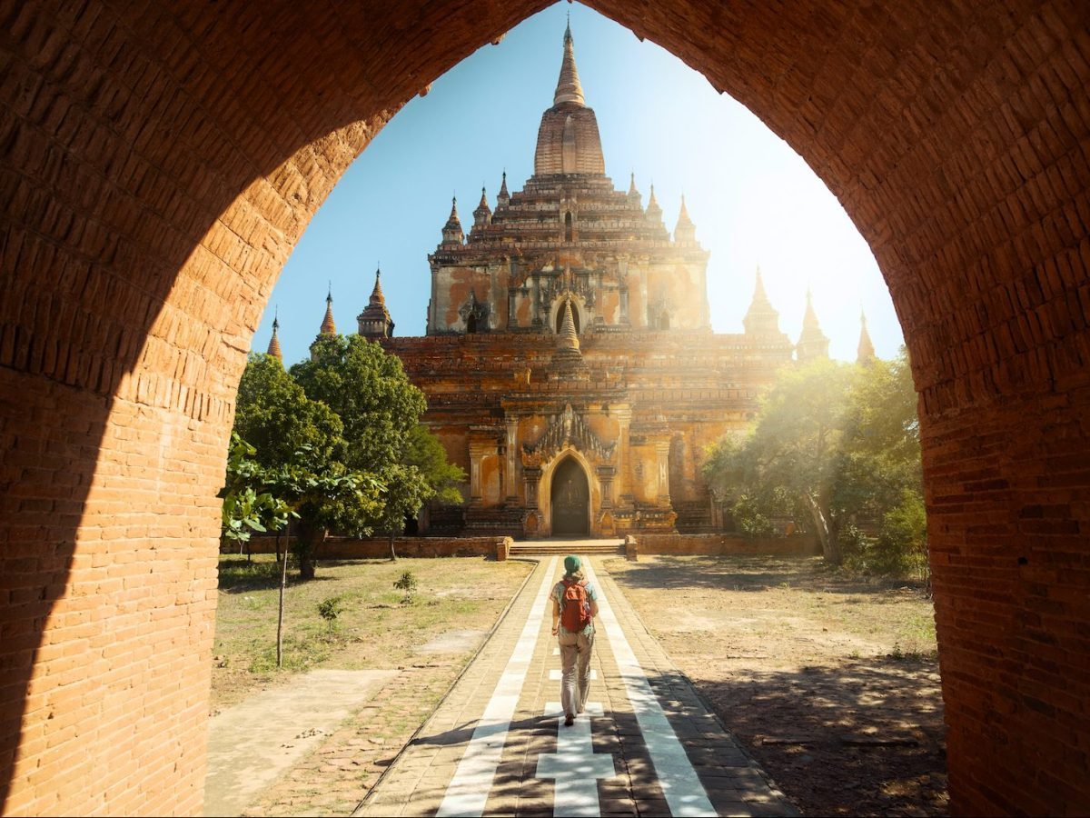 Traveler walking along the road to the Htilominlo temple in Bagan, Myanmar