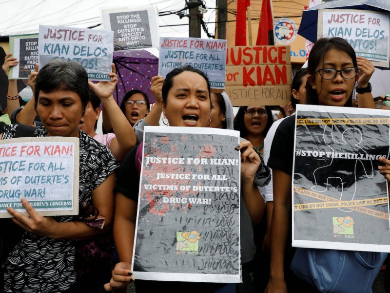 Protesters display placards and chant slogans as they march towards the wake of Kian Loyd delos Santos, a 17-year-old high school student, who was among the people shot dead in a recent escalation of President Rodrigo Duterte's war on drugs Photo: Reuters/Erik De Castro