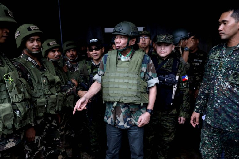 FILE PHOTO: Philippine President Rodrigo Duterte wears a bulletproof vest and a helmet as he gives a pep talk to troops fighting the extremist Maute group in Marawi, Philippines August 24, 2017. Picture taken August 24, 2017.  Presidential Palace/Handout via REUTERS/File Photo  ATTENTION EDITORS - THIS IMAGE HAS BEEN SUPPLIED BY A THIRD PARTY. NO RESALES. NO ARCHIVE.