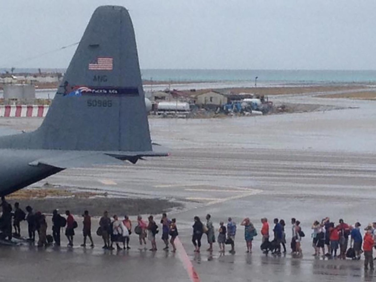 Evacuees fleeing the arrival of Hurricane Irma board a WC-130H of the Puerto Rico Air National Guard in St Martin on Sept. 9, 2017. Photo: USAF/Handout via Reuters