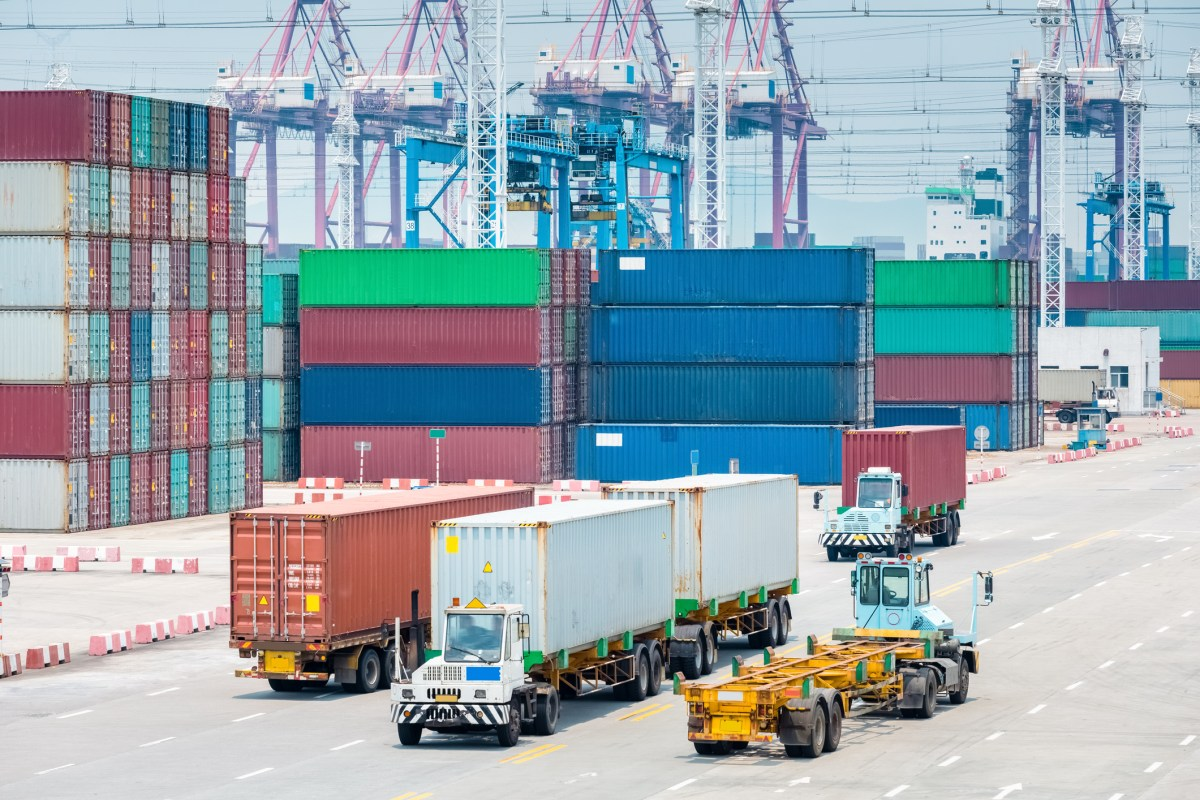 Busy container terminal closeup, brisk trade and economic growth concept Photo: iStock