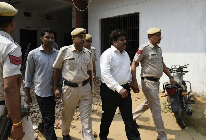 Regional head of Ryan Group of Institutions Francis Thomas (in white shirt) and HR head Jeyus Thomas (grey shirt) at the court in Sohna on Monday. Photo: Hindustan Times