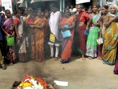 Women burn their free sprees in Hyderabad on Tuesday. Photo: Firstpost