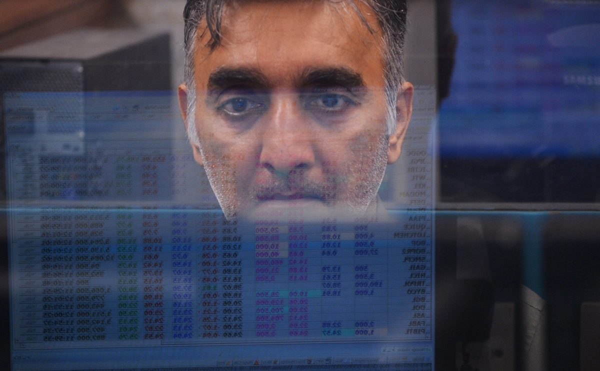 A Pakistani stockbroker is reflected on a monitor as he watches share prices during a trading session at the Pakistan Stock Exchange (PSX) in Karachi. Photo: AFP / Rizwan Tabassum