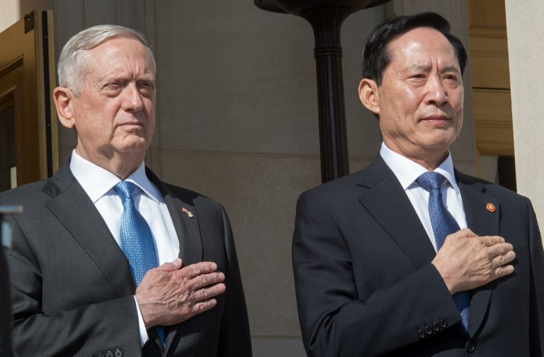 US Secretary of Defense James Mattis and South Korea's Defense Minister Song Young-moo  listen to their respective national anthems upon Young-moo's arrival at the Pentagon in Washington, DC. Photo: Reuters/Paul J Richards