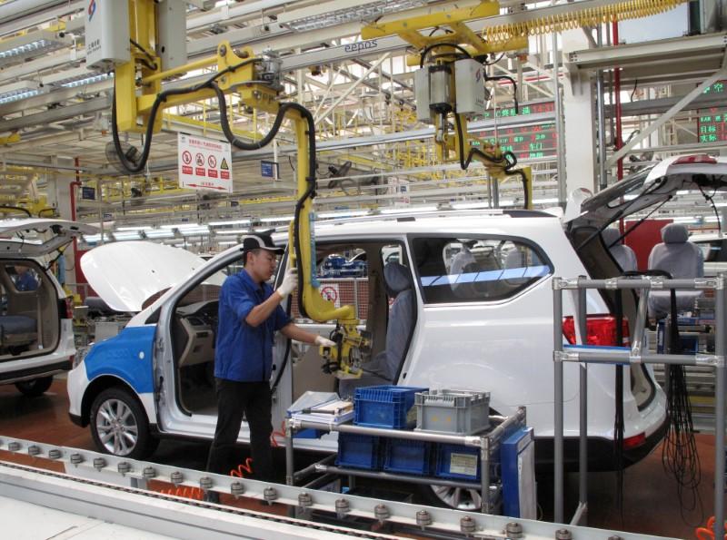 Employees at a production line inside a factory of Saic GM Wuling, in Liuzhou, Guangxi Zhuang Autonomous Region, China, June 19, 2016. Reuters/Norihiko Shirouzu