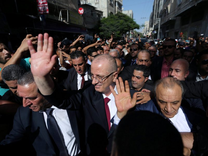 Palestinian Prime Minister Rami Hamdallah waves as he visits the Shejaiya neighborhood in Gaza City, on October 2, 2017. Photo: Reuters / Ibraheem Abu Mustafa