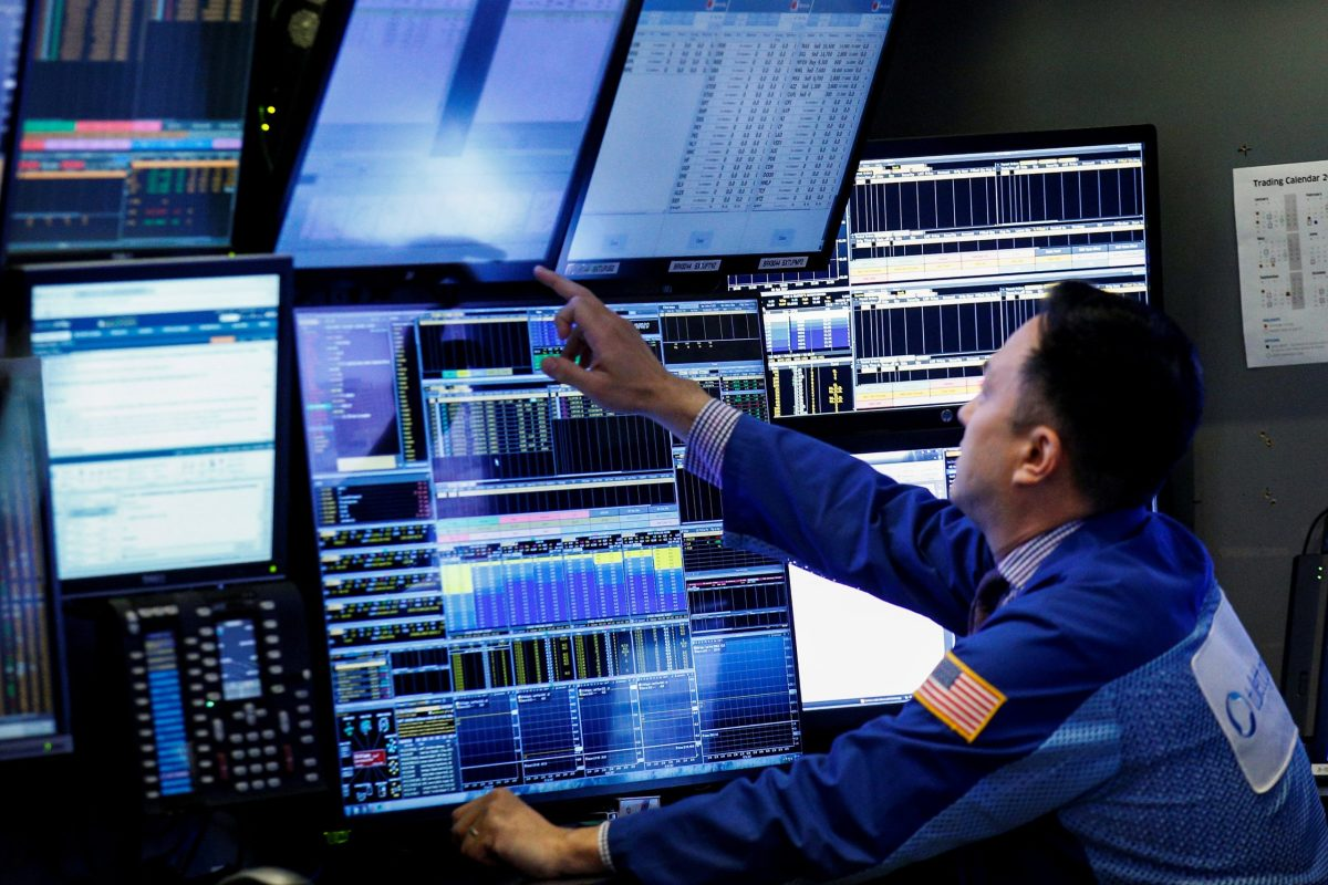 A trader works at a stall on the floor of the New York Stock Exchange. Photo: Reuters/Brendan McDermid