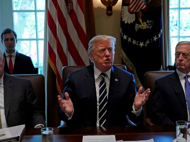Flanked by Secretary of State Rex Tillerson and Defense Secretary James Mattis, U.S. President Donald Trump meets with members of his cabinet at the White House. Photo: Reuters/Kevin Lamarque
