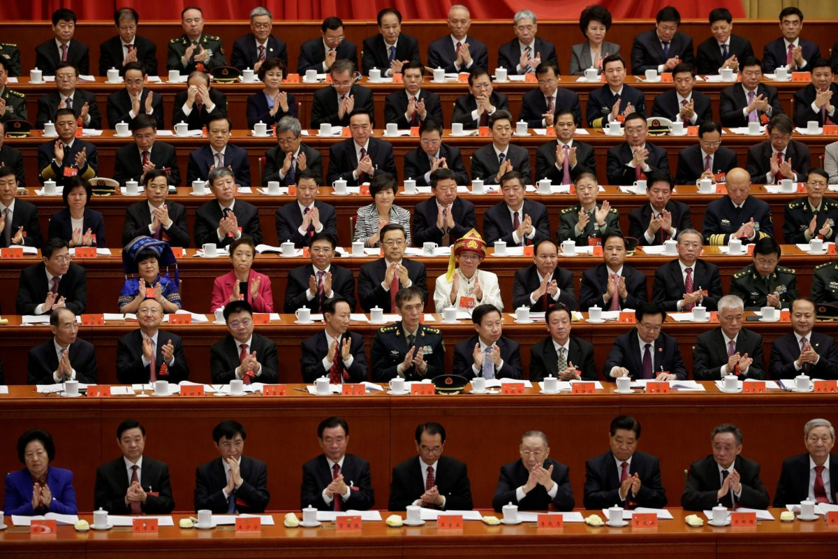 Delegates applaud as Chinese President Xi Jinping delivers his speech during the opening of the 19th National Congress of the Communist Party of China at the Great Hall of the People in Beijing on October 18, 2017. Photo: Reuters / Jason Lee