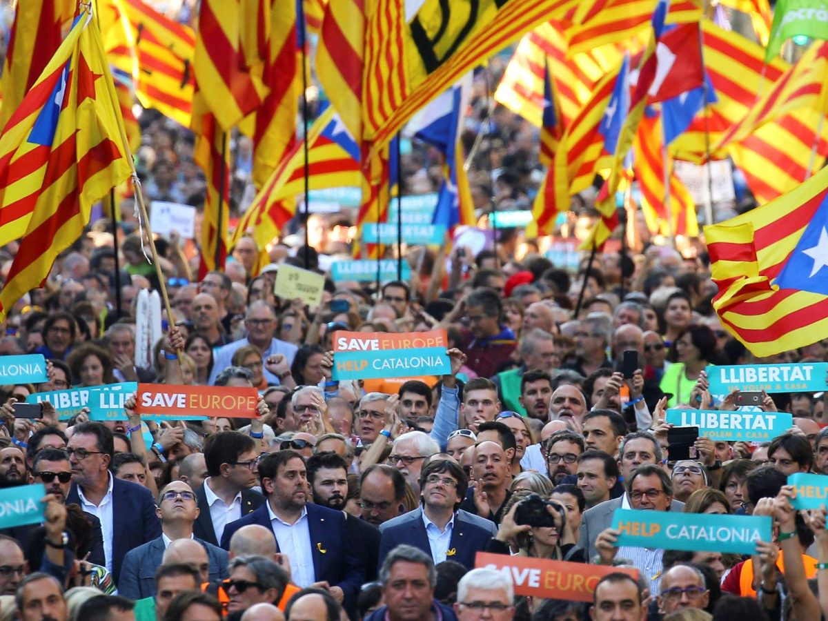Catalan President Carles Puigdemont (C) and other Catalan regional government members attend a demonstration organised by Catalan pro-independence movements on Saturday. Photo: Reuters/Ivan Alvarado