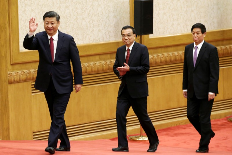 China's new Politburo Standing Committee members (L-R) Xi Jinping, Li Keqiang and Li Zhanshu, arrive to meet with the press at the Great Hall of the People in Beijing,. Photo: Reuters/Jason Lee
