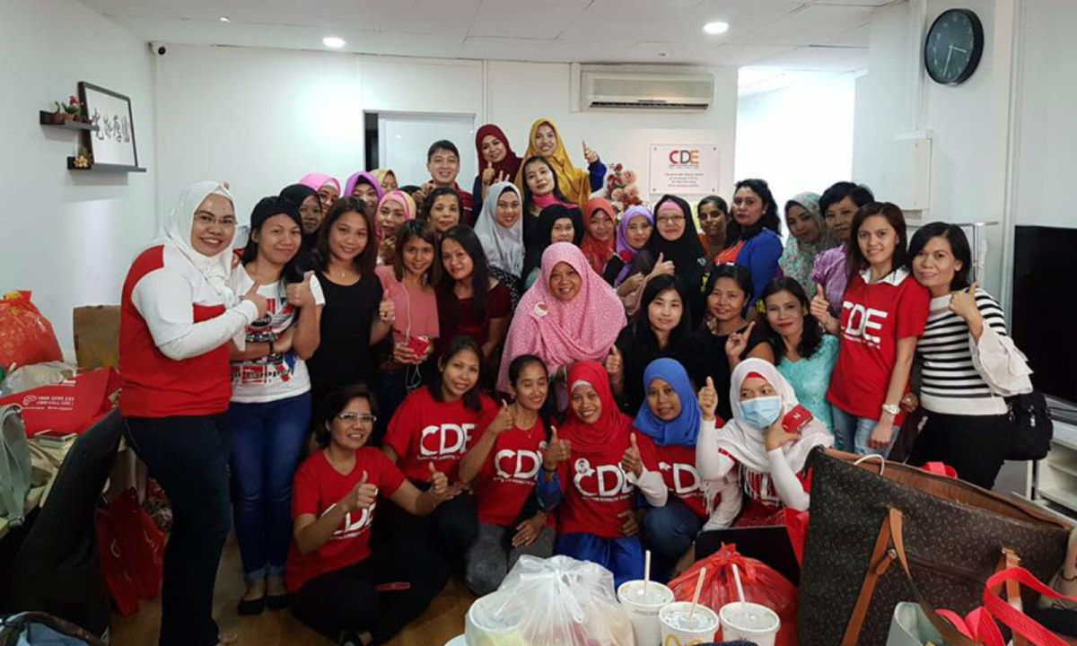 Members of Singapore's Centre for Domestic Employees pose for a picture. Photo: Facebook / CDE