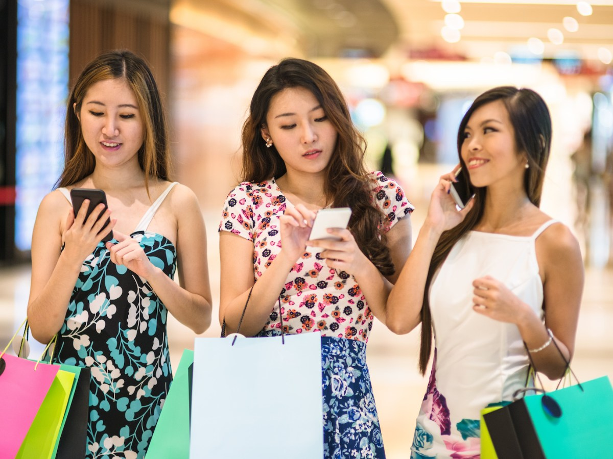 Singaporean women shop while using their smartphones. Southeast Asia has emerged as the world's next e-commerce frontier. Photo: iStock/Getty Images