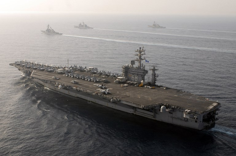 USS Nimitz (bottom) steaming through the Gulf of Oman. Photo: US Navy via AFP
