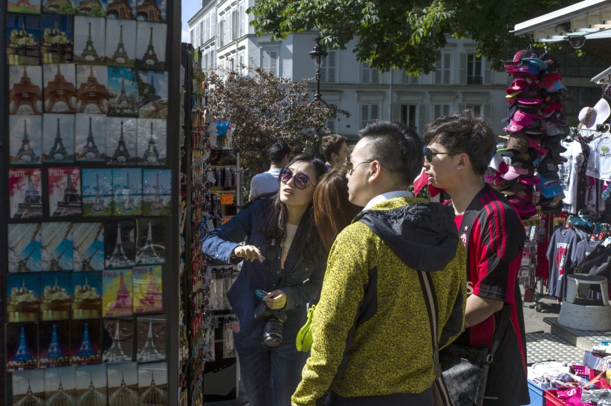 Chinese tourists mill around the Montmartre neighborhood of Paris. Photo: AFP / Fred Dufour