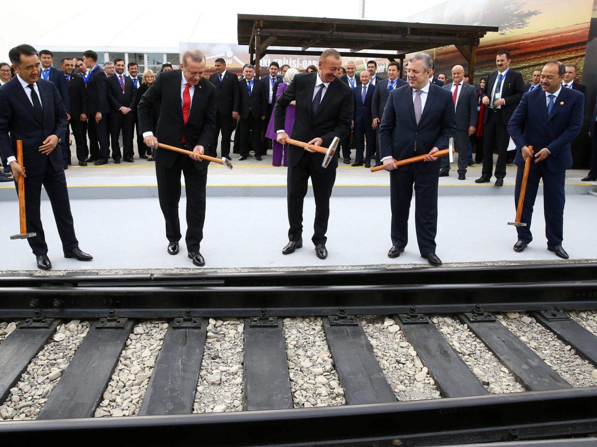 Turkish President Erdogan (C), flanked by his Azeri and Georgian counterparts, attends the inauguration ceremony of Baku - Tbilisi - Kars railway in Alyat, Azerbaijan. Photo: Kayhan Ozer/Turkey's Presidential Palace/Handout via Reuters
