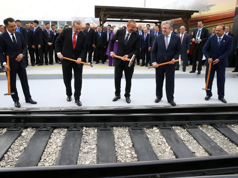 Turkish President Erdogan (C), flanked by his Azeri and Georgian counterparts, attends the inauguration ceremony of Baku - Tbilisi - Kars railway in Alyat, Azerbaijan. Photo: Kayhan Ozer/Turkey's Presidential Palace/Handout via Reuters