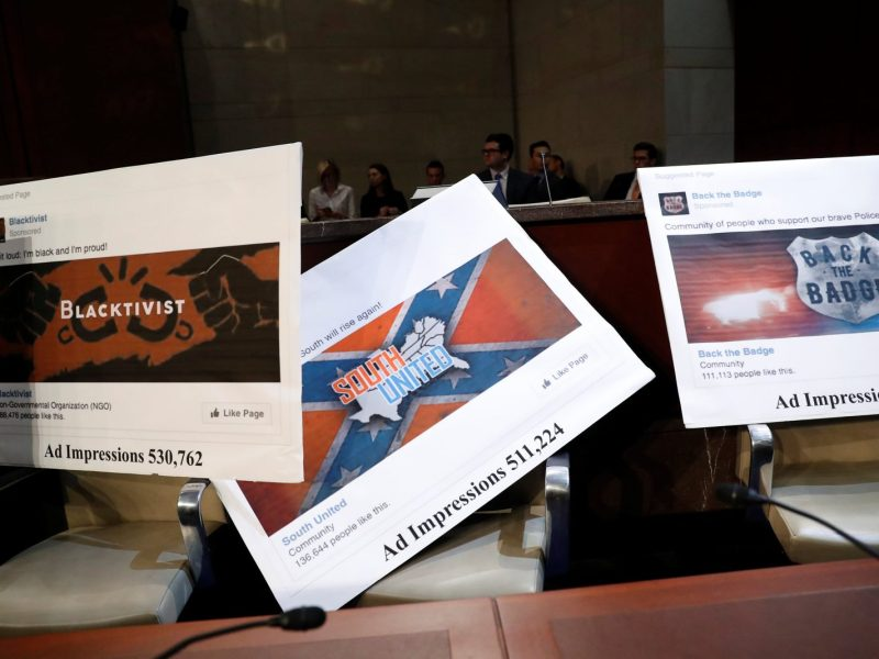 Printed examples of Facebook pages are seen as executives appear before the House Intelligence Committee on November 1, 2017, to answer questions relating to Russian use of social media to influence the 2016 US presidential elections. Photo: Reuters / Aaron P. Bernstein