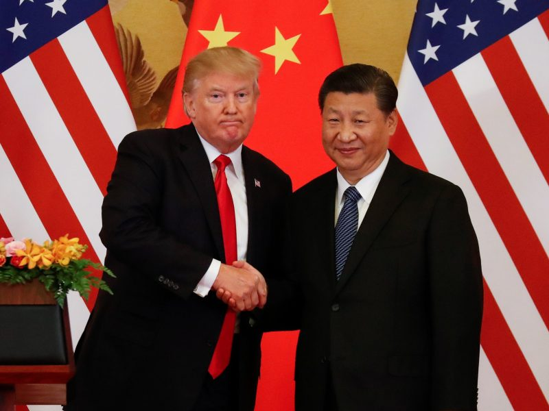 President Trump and China's President Xi Jinping shake hands after making joint statements. Photo: Reuters/Damir Sagolj