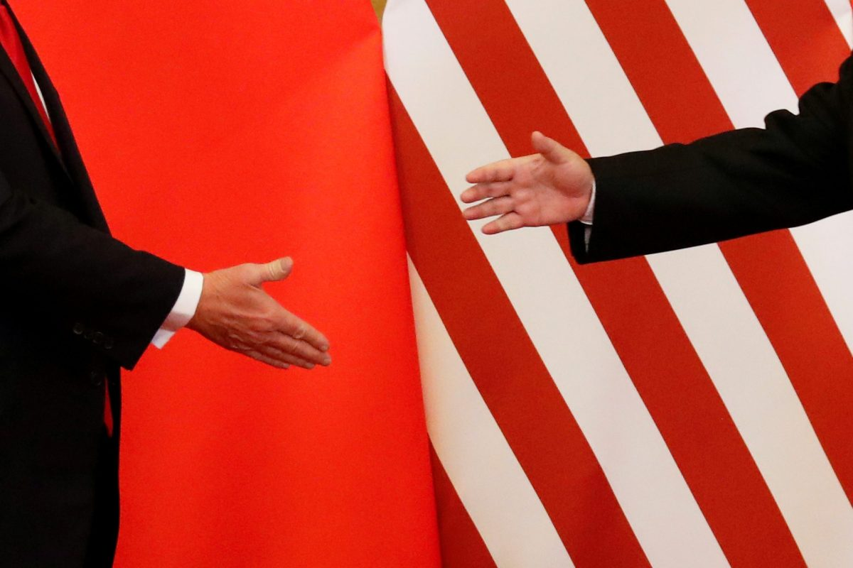 President Donald Trump and China's President Xi Jinping shakes hands after making joint statements at the Great Hall of the People in Beijing, China. Photo: Reuters/Damir Sagolj