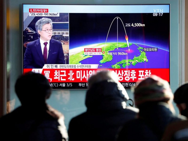 People watch a South Korean television broadcast of a news report on North Korea firing what appeared to be an intercontinental ballistic missile (ICBM) that landed close to Japan. Photo: Reuters / Kim Hong-Ji