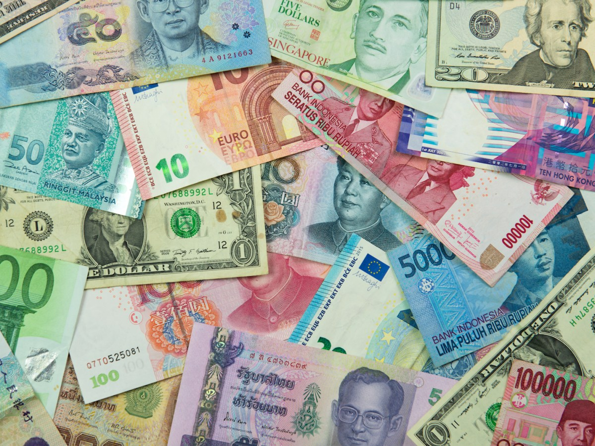 Asian currency banknotes interspersed with US dollars. Photo: iStock/Getty Images.