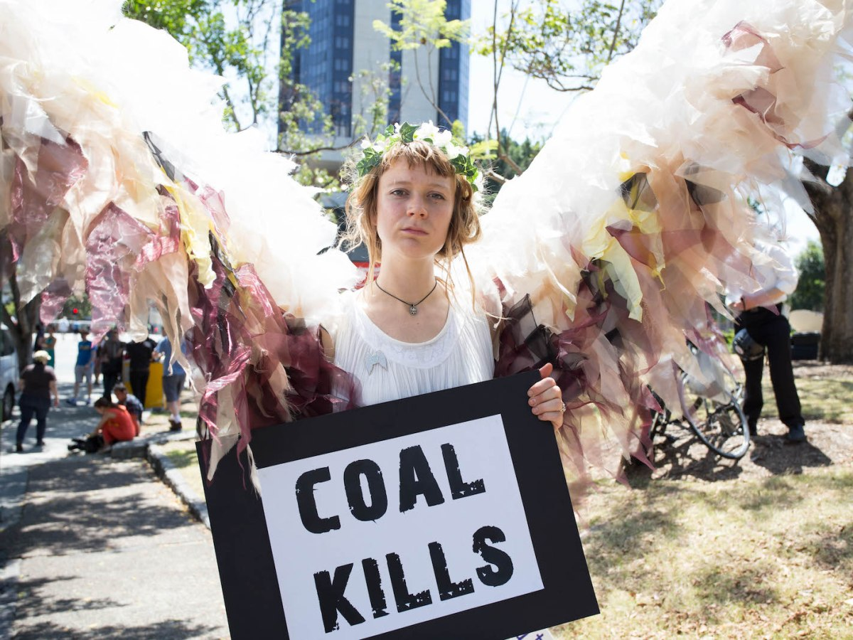 An Australian anti-coal activist from a group called the Climate Guardians joins a People's March in Brisbane in a file photo: Photo: AFP Forum