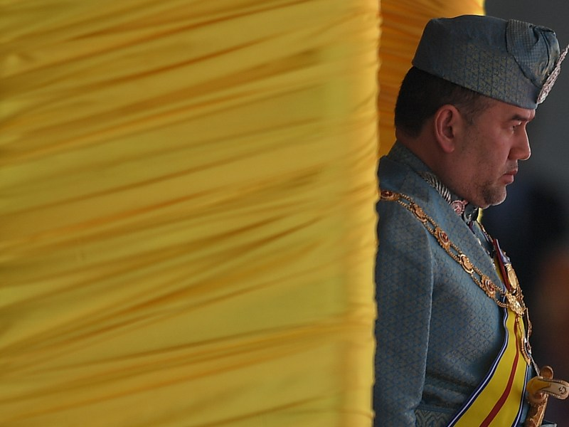 Now abdicated king of Malaysia, Sultan Muhammad V, arrives for a ceremonial guard of honor during the parliamentary opening session at Parliament House in Kuala Lumpur on March 6, 2017. Photo: AFP/Mohd Rasfan