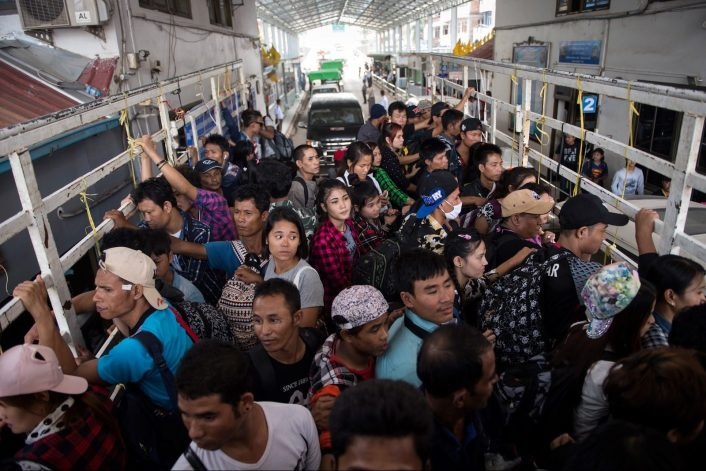 Migrant workers pass the Thai-Myanmar border in an official service truck as they left Thailand from Mae Sot, Tak province in northern Thailand. Photo: AFP/Ye Aung PHOTO / Ye Aung Thu