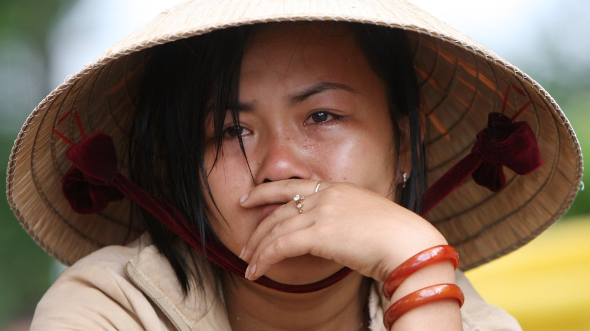 A Vietnamese woman weeps as she waits for news about a family member who went missing during an bridge collapse in a file photo. Photo: AFP/ Stringer