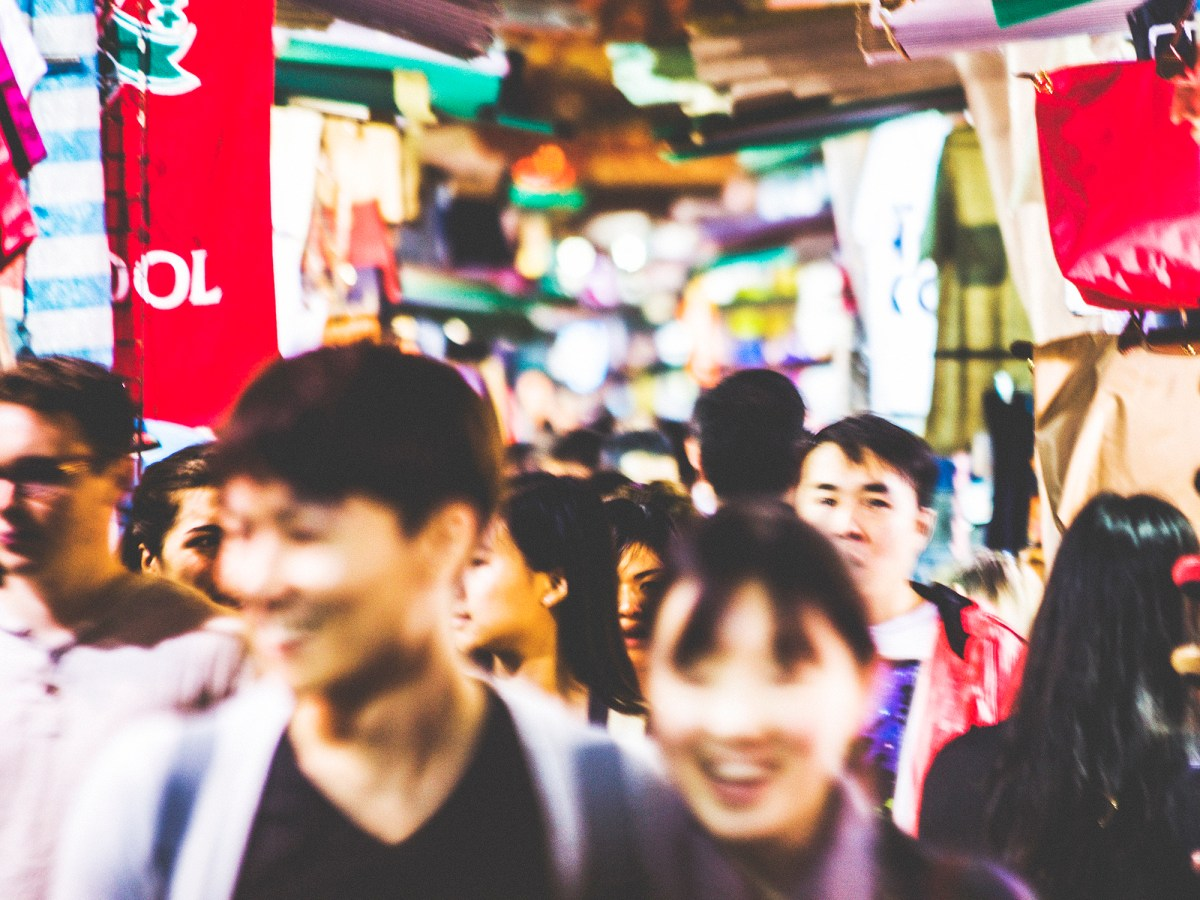 Young Hongkongers explore Kowloon's markets. Photo: iStock / Getty